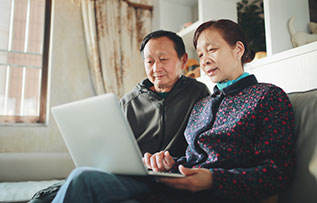 Photo of couple on a laptop. Link to Gifts by Will